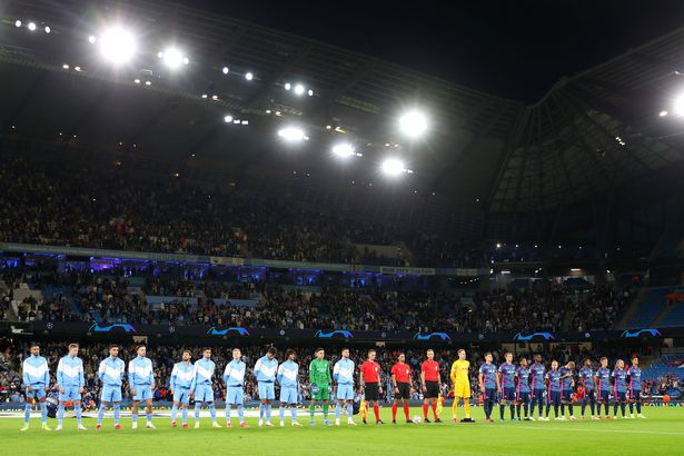 MANCHESTER, ENGLAND - SEPTEMBER 15: Both sets of players and officials line up prior to the UEFA Champions League group A match between Manchester City and RB Leipzig at Etihad Stadium on September 15, 2021 in Manchester, England. (Photo by Matt McNulty - Manchester City/Manchester City FC via Getty Images)