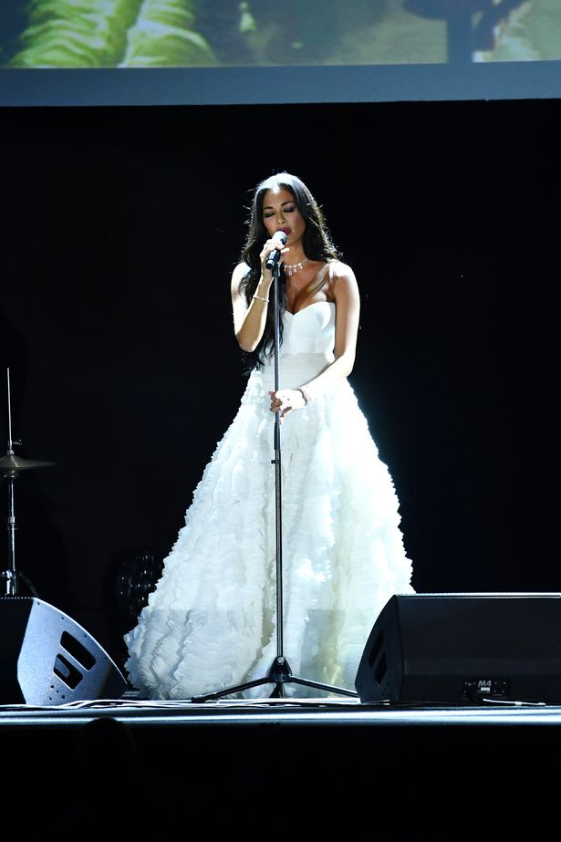Image of Nicole Scherzinger in white gown performing at Venice Film Festival