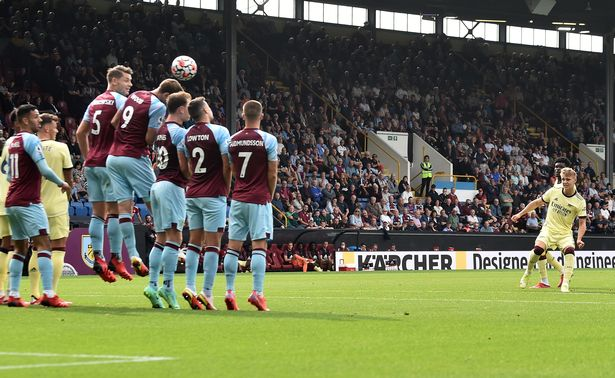 Martin Odegaard of Arsenal scores their side's first goal during the Premier League match between Burnley and Arsenal at Turf Moor on September 18, 2021 in Burnley, England.