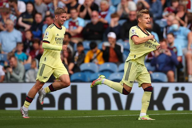 Martin Odegaard of Arsenal celebrates after scoring a goal to make it 0-1 during the Premier League match between Burnley and Arsenal at Turf Moor on September 18, 2021 in Burnley, England.
