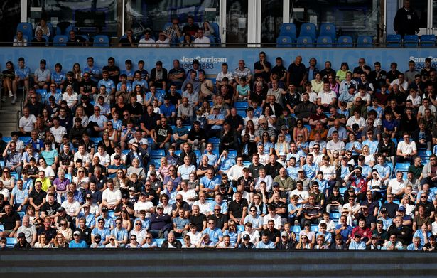 Manchester City fans watch the action during the Premier League match at The Etihad Stadium, Manchester