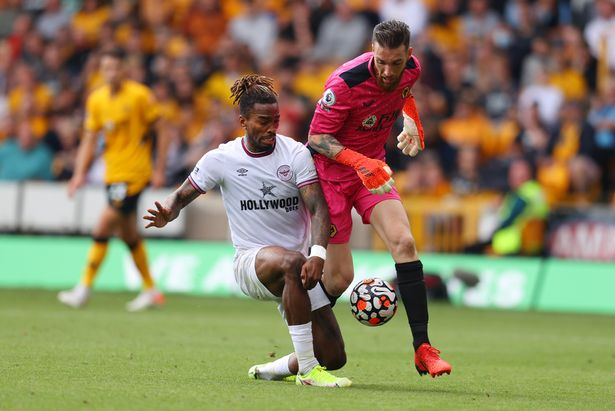 Ivan Toney of Brentford and Jose Sa of Wolverhampton Wanderers battle for possession