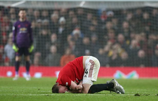 Phil Jones of Manchester United lies injured during the Premier League match between Manchester United and Burnley FC at Old Trafford on January 22, 2020 in Manchester, United Kingdom.