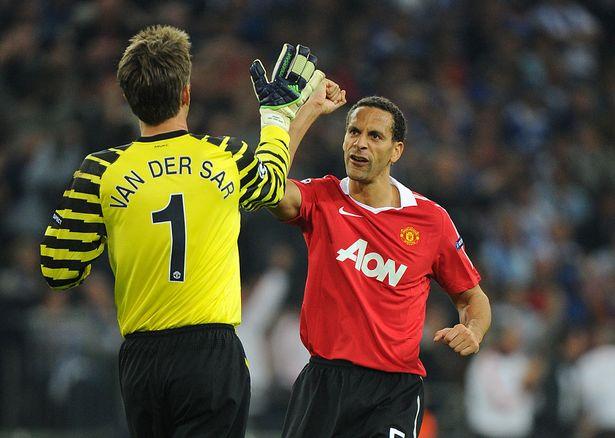 Edwin van der Sar celebrates after Wayne Rooney scored with Rio Ferdinand