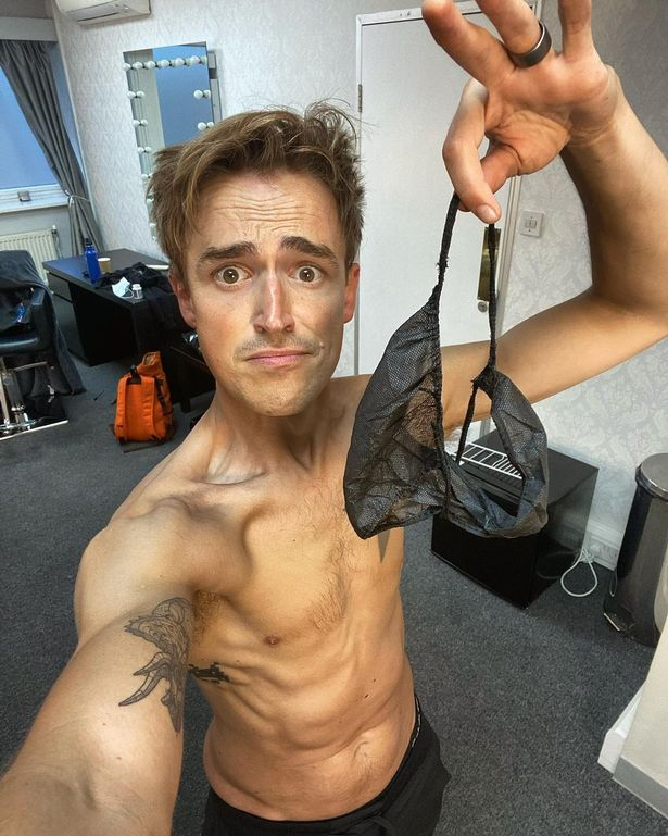 Tom got a slap on the wrist from Instagram after stripping off while getting a spray tan for the show