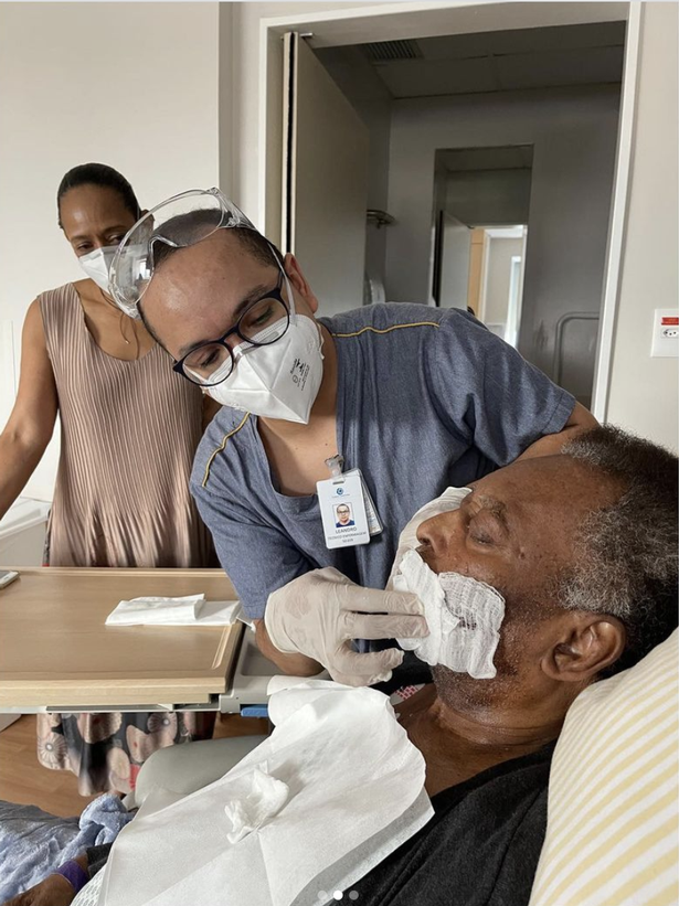 Pele's daughter also posted a picture of Pele being treated by a nurse as he remains in care