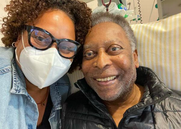 Footy legend Pele rides exercise bike in hospital to show fans he's on the mend