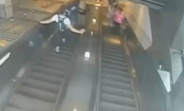 The suspect kicked a 32-year-old woman off an escalator at a Brooklyn subway station