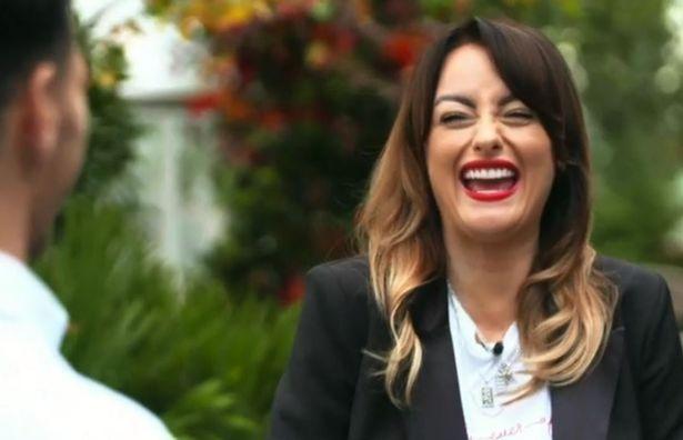 Katie McAlynn laughs