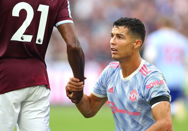 Christiano Ronaldo of Manchester United holds the hand of Angelo Ogbonna of West Ham United during the Premier League match between West Ham United and Manchester United at London Stadium on September 19, 2021 in London, England.