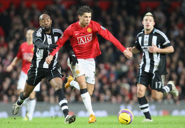 Cristiano Ronaldo of Manchester United clashes with Claudio Cacapa of Newcastle United during the Barclays FA Premier League match between Manchester United and Newcastle United at Old Trafford on January 12 2008 in Manchester, England