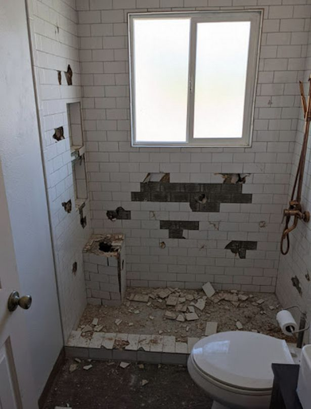 Trucke said his hammer blows actually damaged the dry wall behind the tiles