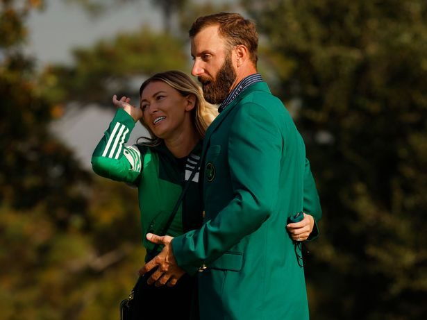 Dustin Johnson celebrates with his green jacket and partner Paulina Gretzky after winning The Masters in 2020.