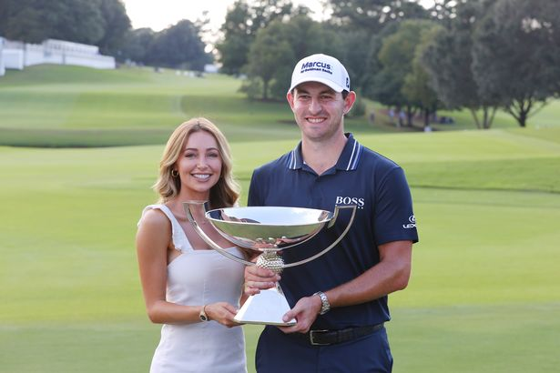 Patrick Cantlay celebrates with girlfriend Nikki Guidish after winning the FedEx Cup earlier this month.