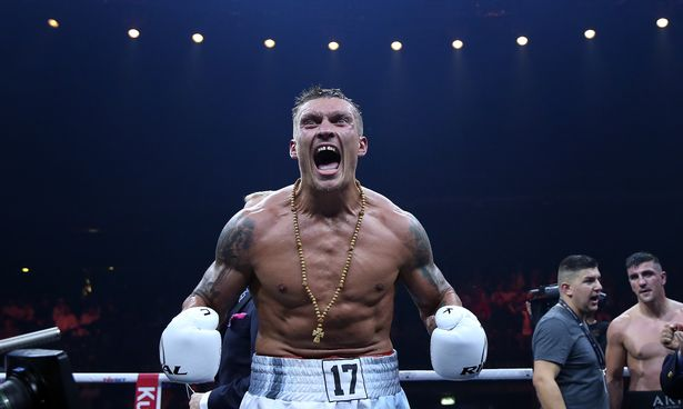 Aleksandr Usyk of Ukraine celebrates after winning the WBO Cruiserweight World Boxing Super Series fight against Marco Huck