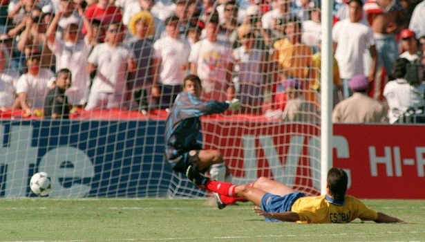 File photo dated 22 June 1994 shows Colombia defender Andres Escobar (R) laying on the pitch as he deflects a shot by John Harkes of the US into his own goal during their 94 World Cup match at the Rosa Bowl