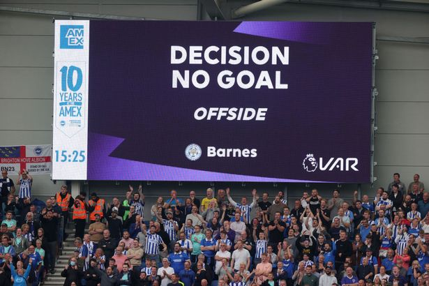 A VAR check rules Harvey Barnes of Leicester City's goal offside during the Premier League match between Brighton & Hove Albion and Leicester City at American Express Community Stadium on September 19, 2021 in Brighton, England.