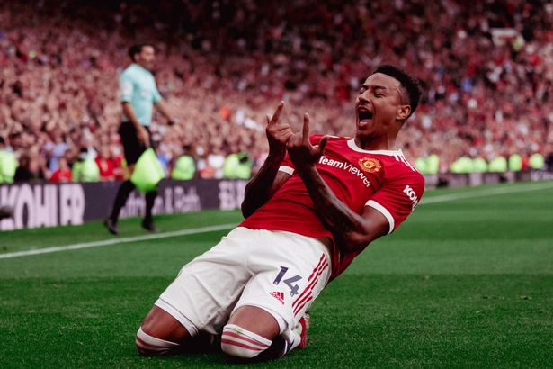 Jesse Lingard of Manchester United celebrates scoring their fouth goal during the Premier League match between Manchester United and Newcastle United at Old Trafford on September 11, 2021 in Manchester, England.