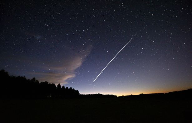 This long-exposure image shows a trail of a group of SpaceX's Starlink satellites passing over Uruguay as seen from the countryside some 185 km north of Montevideo near Capilla del Sauce, Florida Department, on February 7, 2021. (Photo by Mariana SUAREZ / AFP) (Photo by MARIANA SUAREZ/AFP via Getty Images) URUGUAY-SPACE-SPACEX-SATELLITE-STARLINK