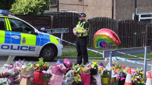 Tributes have been pouring in for the victims, with people leaving flowers near the property