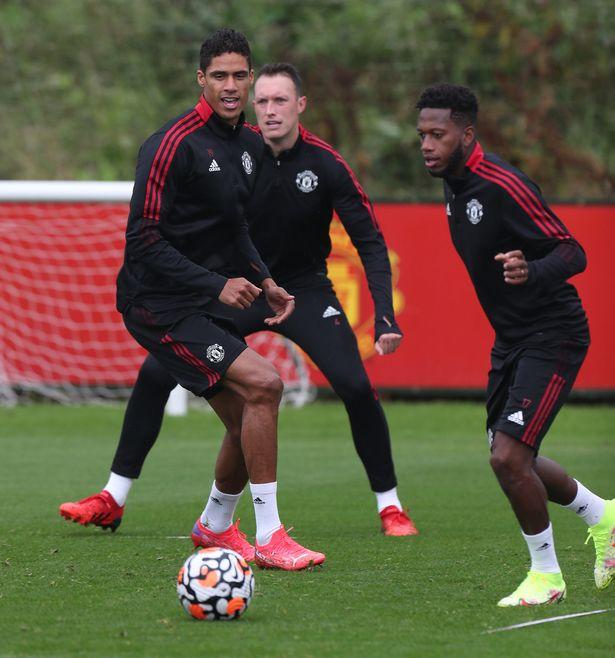 Phil Jones training with Man Utd team-mates Raphael Varane and Fred