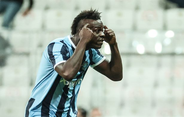 Mario Balotelli of Adana Demirspor celebrates in front of Besiktas manager Sergen Yalcin by pointing to his head after scoring