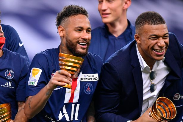 Neymar Jr and Kylian Mbappe of Paris Saint-Germain raise the Trophy after winning the French League Cup ( Coupe de France) final match against Olympique Lyonnais after the penalty kick session at Stade de France on July 31, 2020 in Paris, France