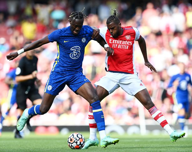 LONDON, ENGLAND - AUGUST 01: Tammy Abraham of Chelsea battles for possession with Nuno Tavares of Arsenal during the Pre-Season Friendly match between Arsenal and Chelsea at Emirates Stadium on August 01, 2021 in London, England. (Photo by Darren Walsh/Chelsea FC via Getty Images)