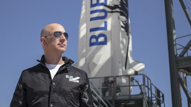 """(FILES) This file handout photo taken on April 24, 2015 obtained courtesy of Blue Origin shows Jeff Bezos, founder of Blue Origin, at New Shepard's West Texas launch facility before the rocket's maiden voyage. - Jeff Bezos sets his sights on a new frontier in space in the coming days after building a gargantuan business empire which has in many ways conquered the Earth. (Photo by - / BLUE ORIGIN / AFP) / == RESTRICTED TO EDITORIAL USE / MANDATORY CREDIT: """"AFP PHOTO / BLUE ORIGIN"""" / NO MARKETING / NO ADVERTISING CAMPAIGNS / DISTRIBUTED AS A SERVICE TO CLIENTS == (Photo by -/BLUE ORIGIN/AFP via Getty Images) FILES-US-SPACE-TOURISM-BLUEORIGIN-BEZOS"""