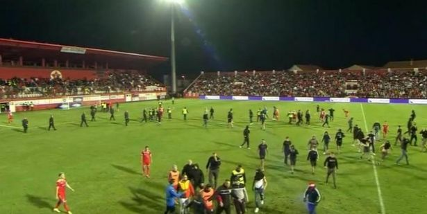 Fans had stormed the pitch in the 82nd minute