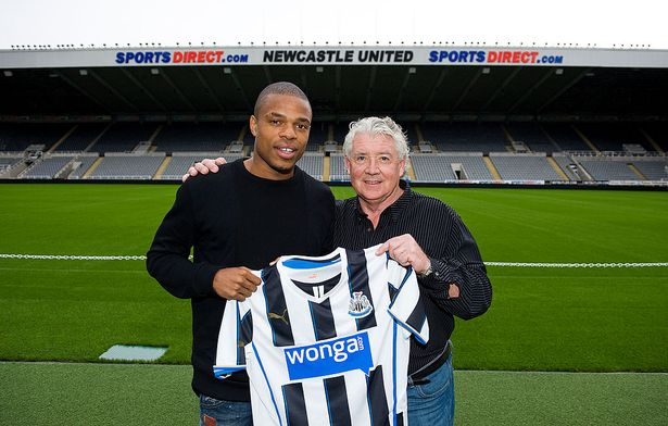 Newcastle United's new signing Loic Remy (L) and Director of football at Newcastle United Joe Kinnear pose for the media at St. James' Park on August 5, 2013, in Newcastle upon Tyne, England.