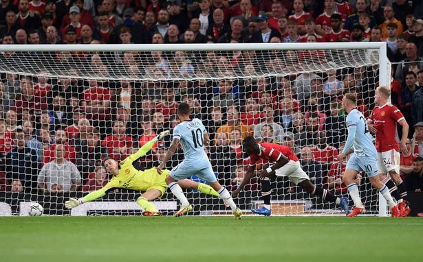 West Ham United's Argentinian midfielder Manuel Lanzini scores his team's first goal past Manchester United's English goalkeeper Dean Henderson during the English League Cup third round football match between Manchester United and West Ham United at Old Trafford in Manchester, north west England, on September 22, 2021.