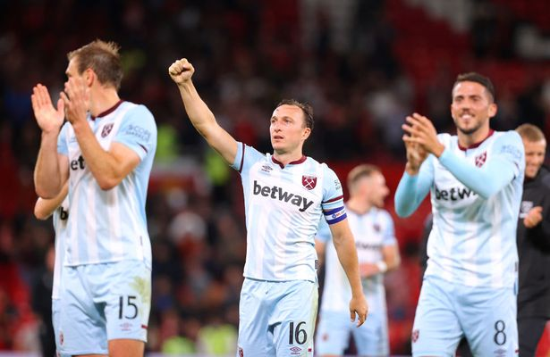 Mark Noble of West Ham United celebrates with team mates after the Carabao Cup Third Round match between Manchester United and West Ham United at Old Trafford on September 22, 2021 in Manchester, England.