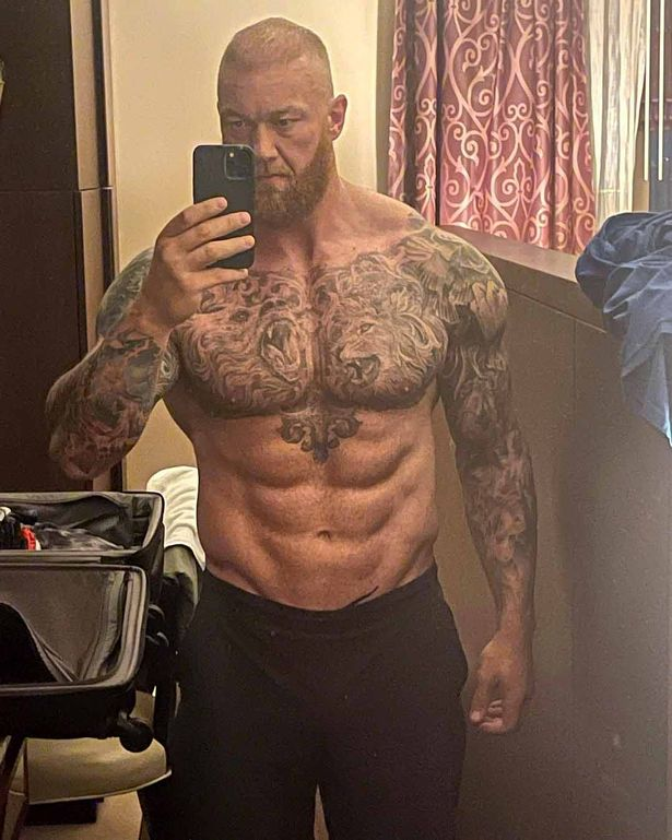Hafthor Bjornsson shows off his impressive weight loss with a topless mirror picture