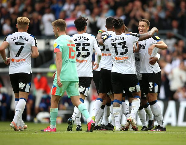 Derby County's Curtis Davies celebrates after scoring his sides first goal during the Sky Bet Championship match at Pride Park, Derby. Picture date: Saturday August 7, 2021.