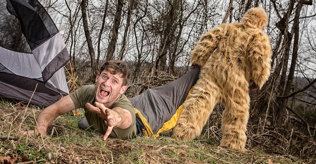A Bigfoot creature dragging a camper