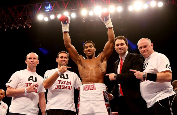 Anthony Joshua celebrates his victory over Emanuele Leo during their Heavyweight bout at O2 Arena on October 5, 2013 in London, England