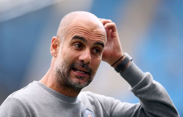 Pep Guardiola, Manager of Manchester City looks on prior to the Premier League match between Manchester City and Southampton at Etihad Stadium on September 18, 2021 in Manchester, England.