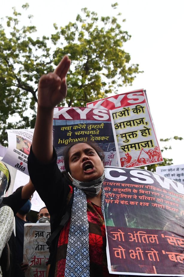 People in India protesting a gang-rape and murder last year