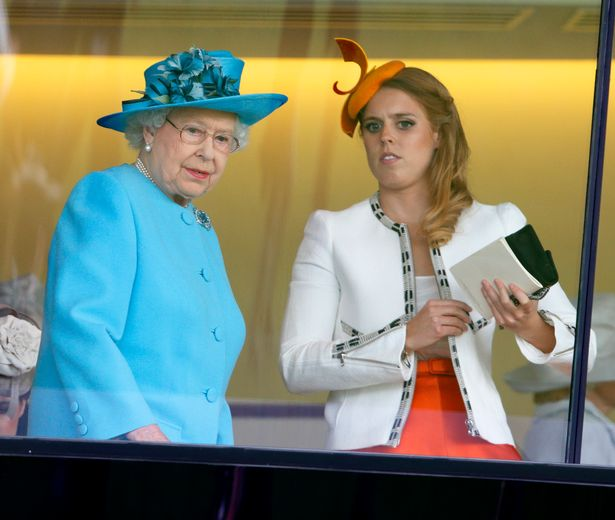 ASCOT, UNITED KINGDOM - JUNE 19: (EMBARGOED FOR PUBLICATION IN UK NEWSPAPERS UNTIL 48 HOURS AFTER CREATE DATE AND TIME) Queen Elizabeth II talks with Princess Beatrice of York after watching her horse Estimate finish second in the Gold Cup on Day 3, Ladies Day, of Royal Ascot at Ascot Racecourse on June 19, 2014 in Ascot, England. (Photo by Max Mumby/Indigo/Getty Images)