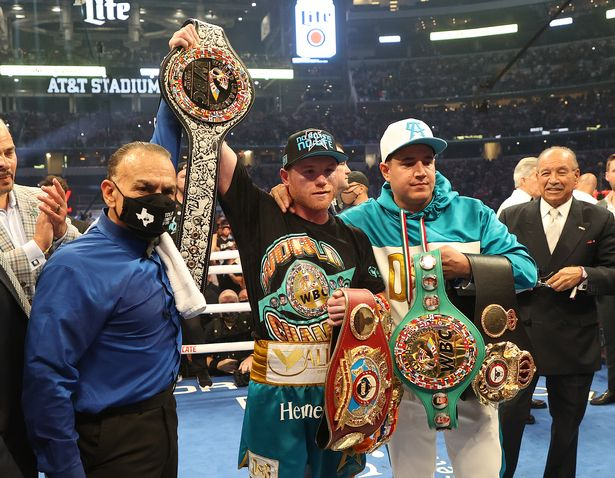 Canelo Alvarez celebrates after defeating Billy Joe Saunders who did not answer the bell for the eighth round during their fight for Alvarez's WBC and WBA super middleweight titles and Saunders' WBO super middleweight title at AT&T Stadium on May 08, 2021 in Arlington, Texas