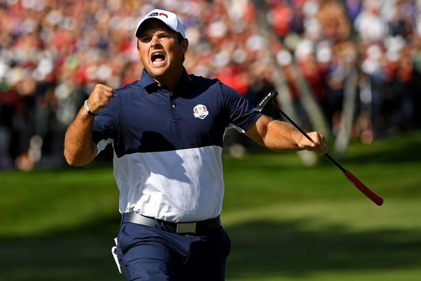 Patrick Reed celebrates winning a hole