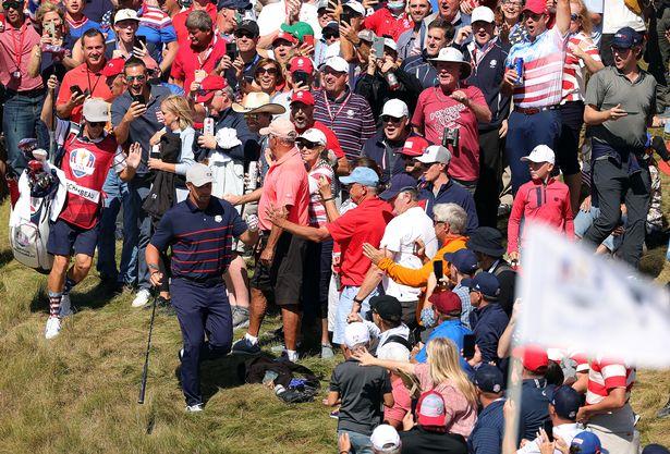 DeChambeau located the fan after his wayward tee shot