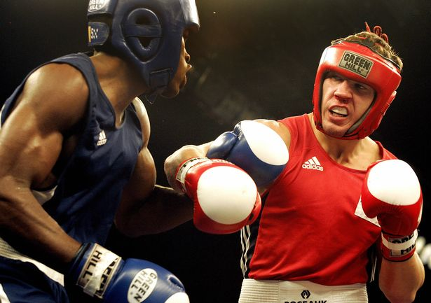 MIANYANG, CHINA: Korobov Matvey (R) of Russia exchanges punches with Emilio Correa Bayeux of Cuba during their 75 kg category semi-final of the13th World Senior Boxing Championships in Mianyang city, in China's southwestern province of Sichuan, 19 November 2005