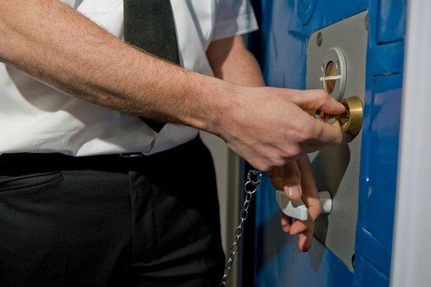 prison officer locks cell door