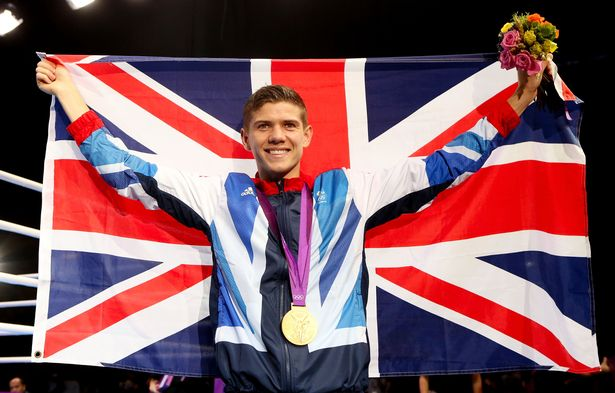Gold medalist Luke Campbell of Great Britain celebrates after the medal ceremony for the Men's Bantam (56kg) Boxing final bout on Day 15 of the London 2012 Olympic Games