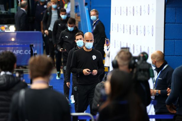 Pep Guardiola, Manager of Manchester City arrives at the stadium prior to the Premier League match between Chelsea and Manchester City at Stamford Bridge on September 25, 2021 in London