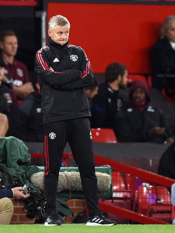 Manchester United's Norwegian manager Ole Gunnar Solskjaer reacts during the English League Cup third round football match between Manchester United and West Ham United at Old Trafford