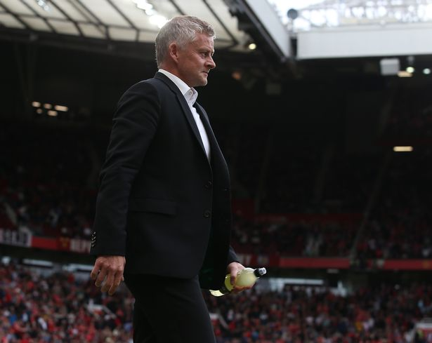 Ole Gunnar Solskjaer of Manchester United walks out ahead of the second half of the Premier League match between Manchester United and Aston Villa at Old Trafford on September 25, 2021