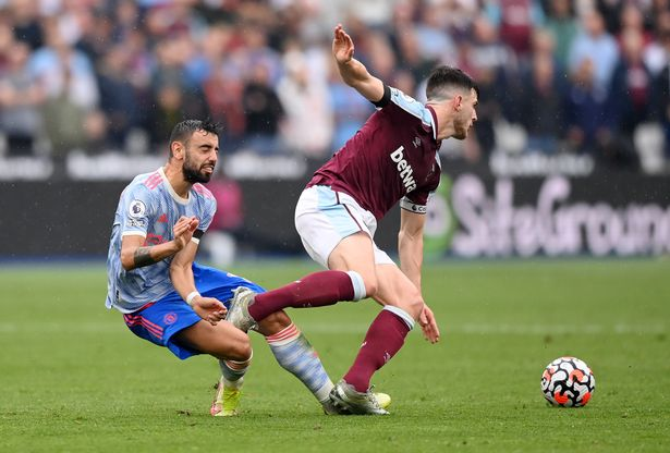 Bruno Fernandes of Manchester United is challenged by Declan Rice of West Ham United during the Premier League match between West Ham United and Manchester United